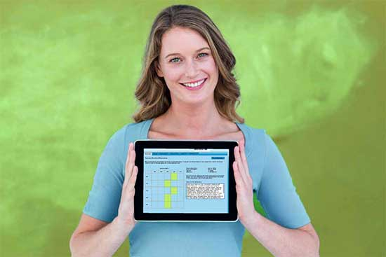 Teacher displays TIM Observation Tool on her tablet computer.